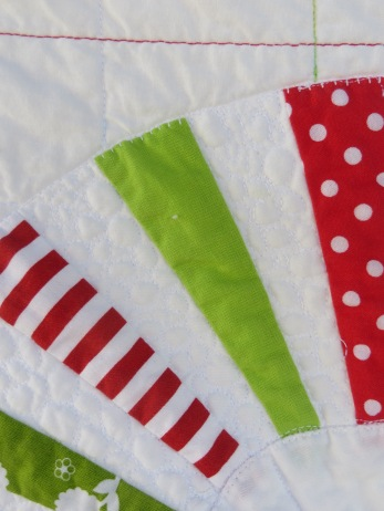 Close up of pebble stitch quilting and blanket stitch appliqué.
